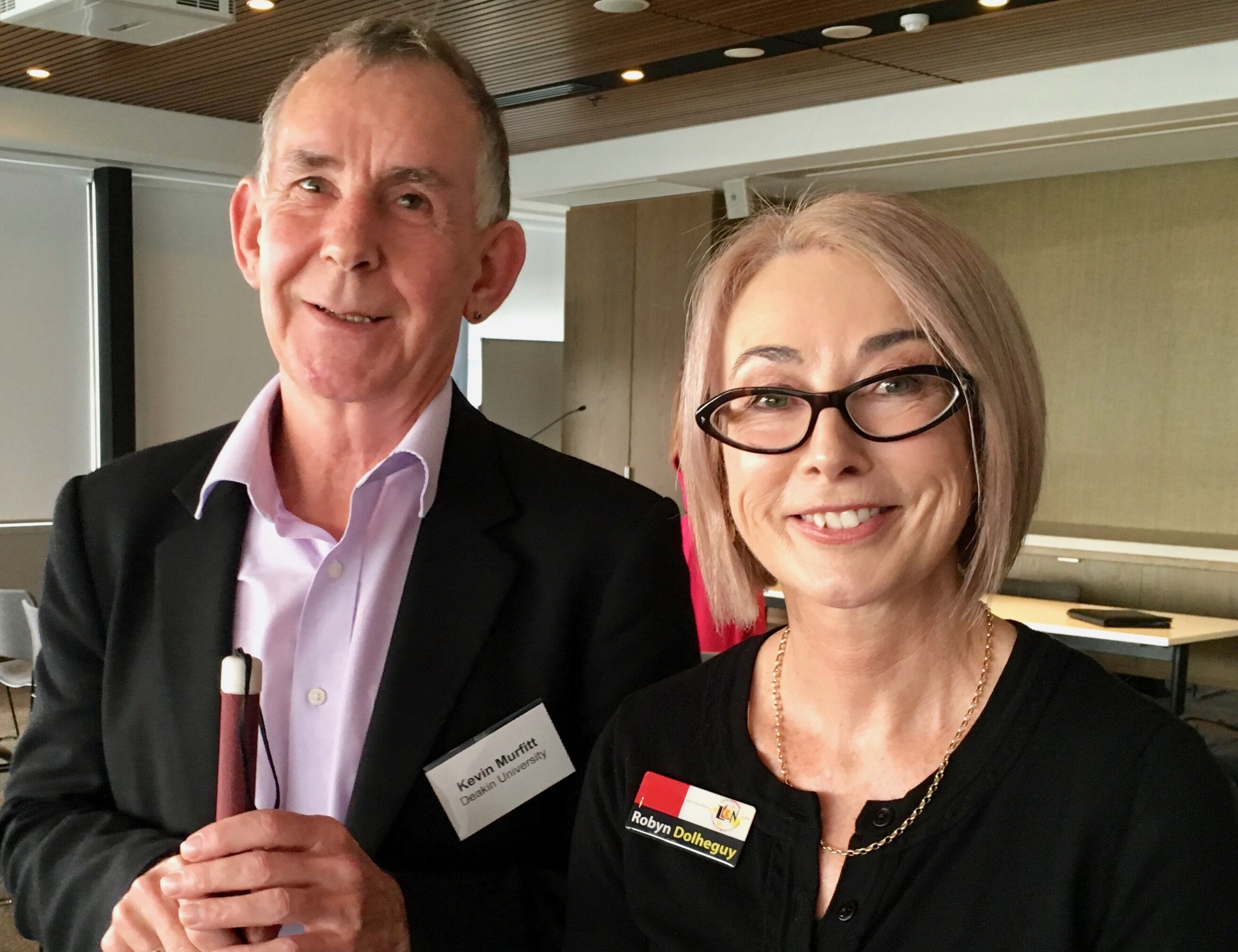 Kevin Murfitt, Deakin University & Robyn Dolheguy, Geelong LLEN standing together smiling at the camera