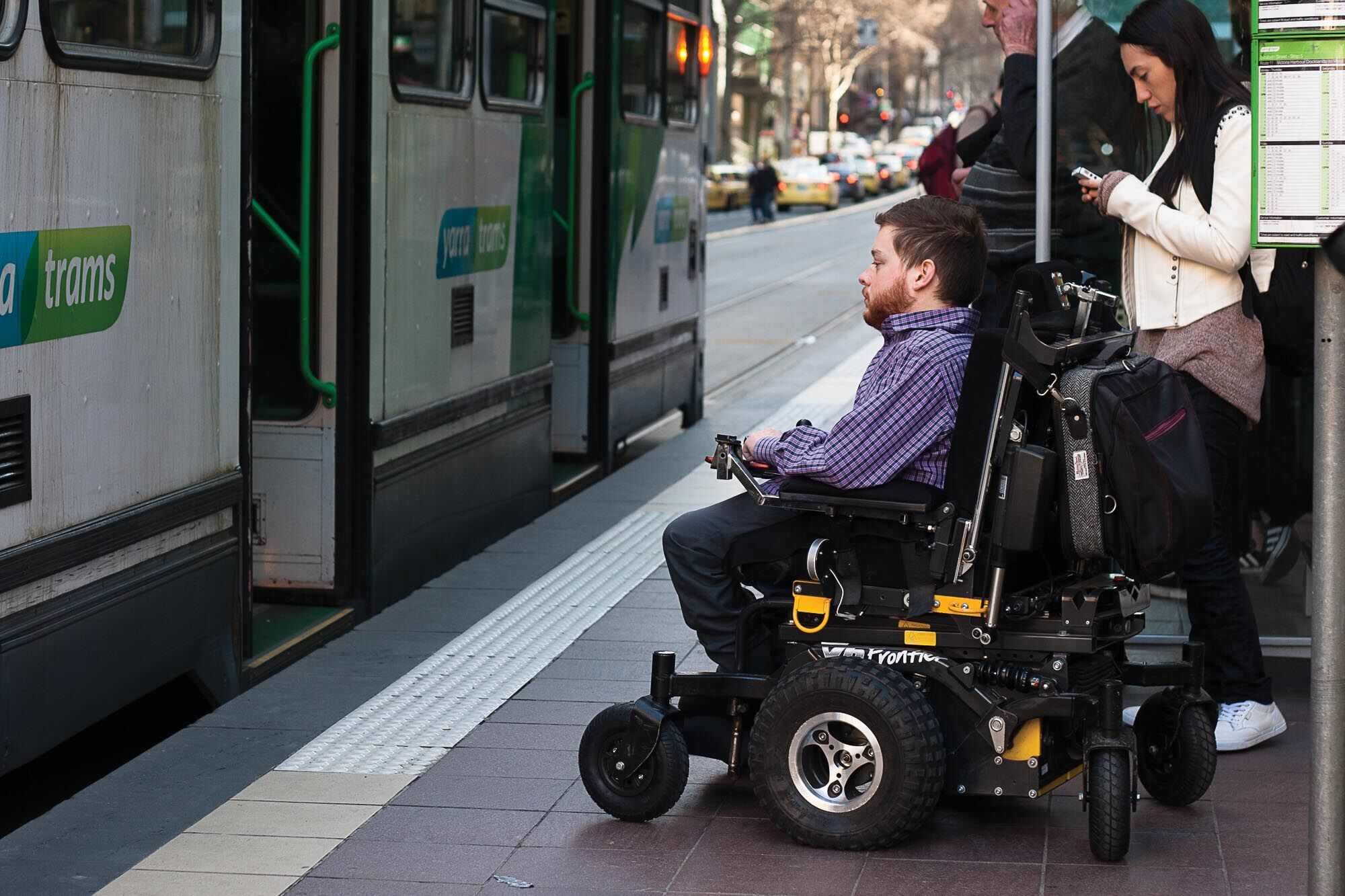 image of wheelchair user waiting at an accessible tram stop.